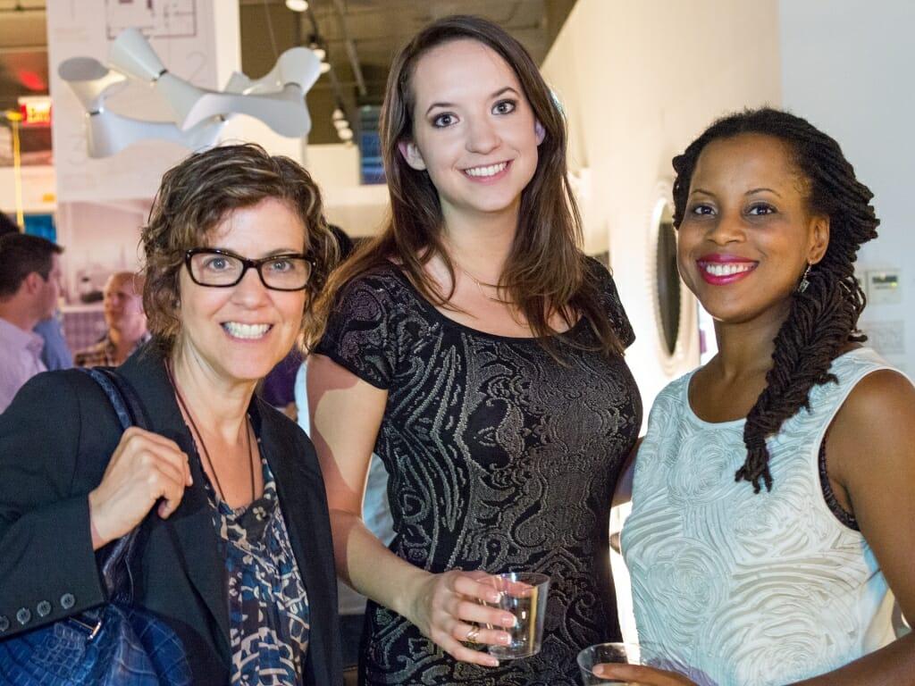 Co-founder Joyce Elizabeth poses with designers Mary Davis and Mindy Greenberg