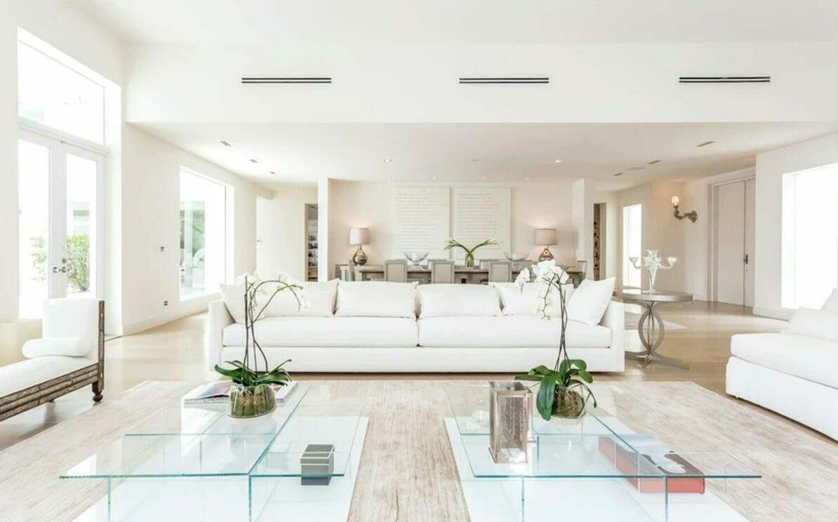 Bright white contemporary living room by top interior decorator miami