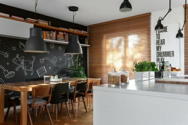 modern-kitchen-chalkboard-wall-ideas-solid-wood-dining-table-white-cabinets