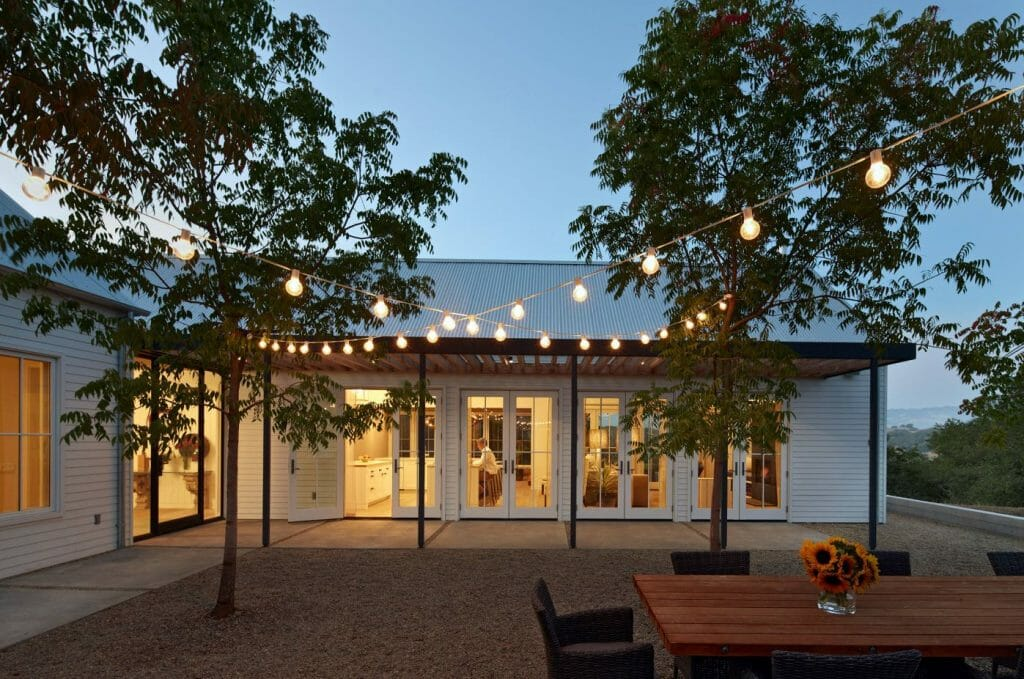 top backyard lighting trends cafe lighting over dining