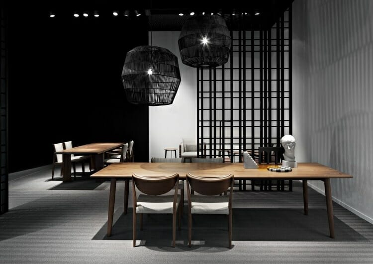 Contemporary open plan living with wood and black pendant lighting