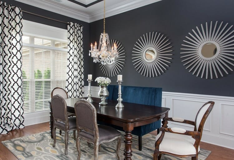 transitional dining interior with contemporary art and classic furniture