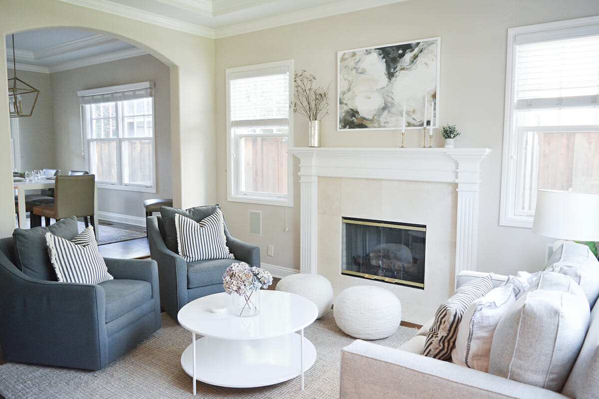 interior-design-help-transitional-living-room-with-feature-fireplace-white-coffee-table-and-painting