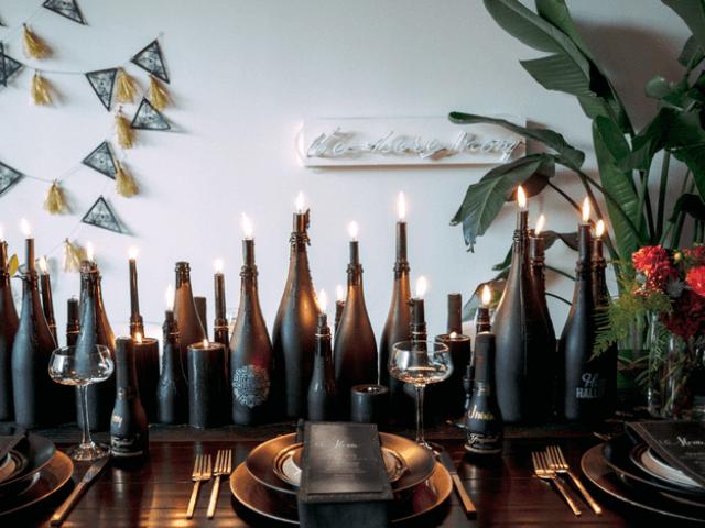 modern halloween decorations wine bottles as runner