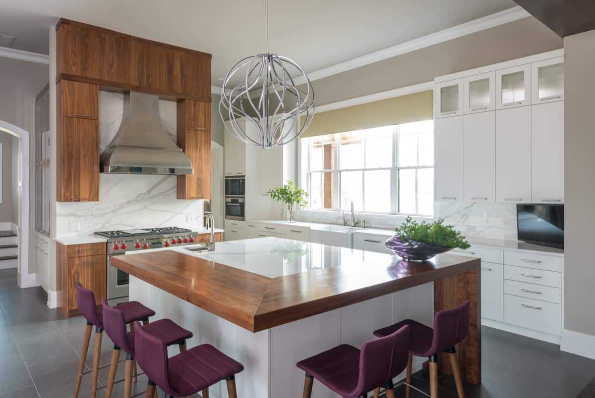 dallas interior designers - traci connell interiors - bright kitchen and bar with purple bar stools