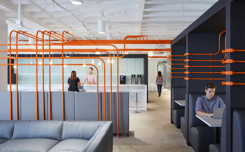 modern-office-design-orange-conduit-pipes-design-feature-wayfinding-path
