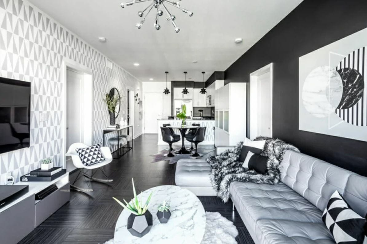 Color-coordinated black and white modern apartment design with modern apartment decor by Michelle B