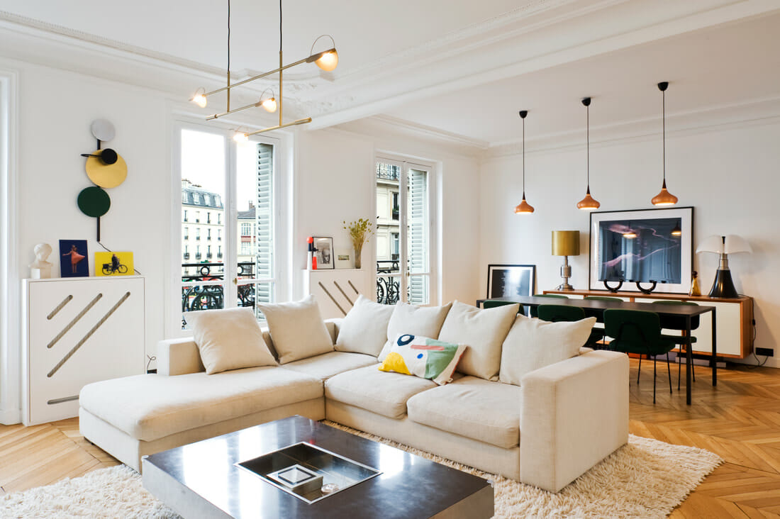 Cozy mid-century modern apartment design with contemporay lighting for a living and dining room by Tatiana nicol