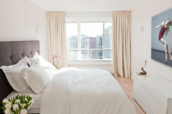 Romantic bedroom with modern apartment decor ideas like floor-to-ceiling curtains by Tatiana