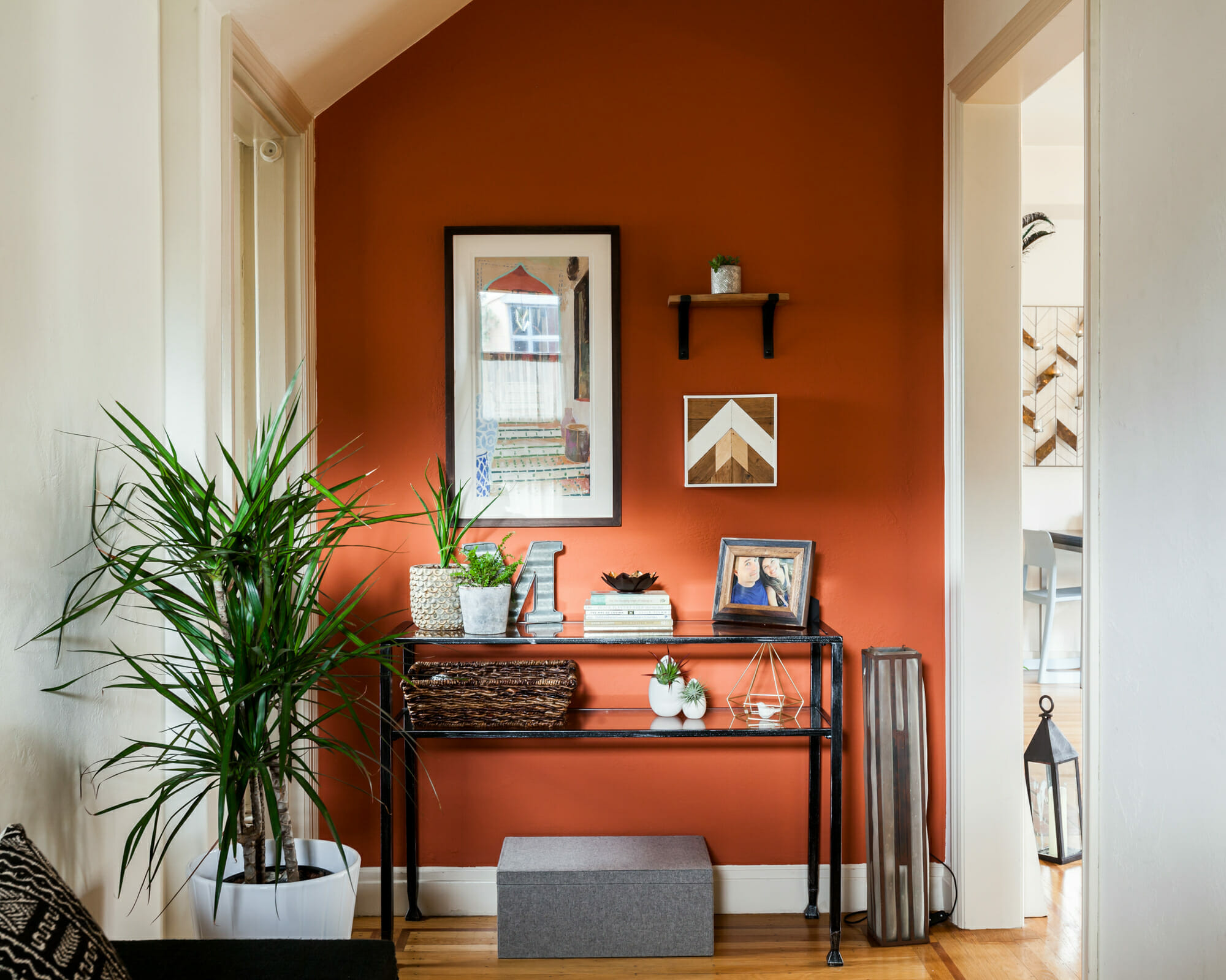 Entryway design in burnt orange fall color theme by Decorilla designer, Christine M.
