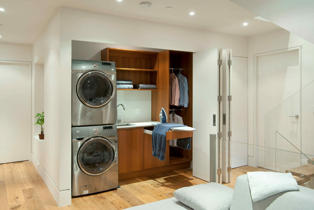 small laundry room ideas with a Built-in-Ironing-Board