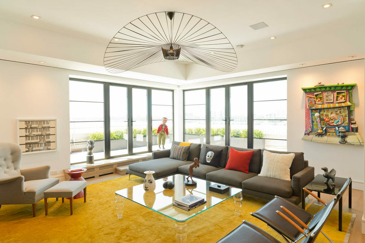 Bright rug in pantone color of the year gives a pop of color to this NYC penthouse