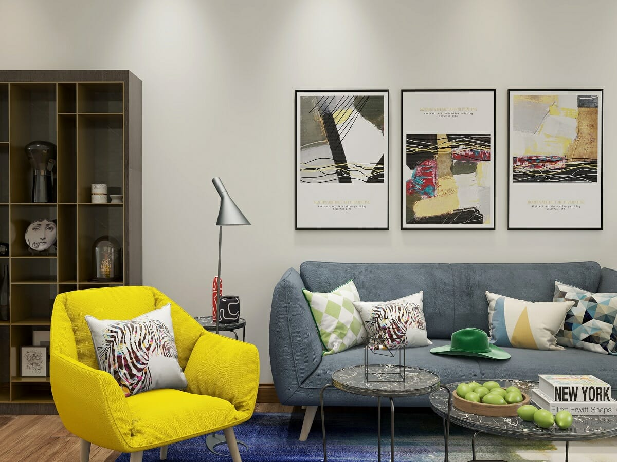 Contemporary modern lounge with a yellow occasional chair and geometric print scatters by online interior designer Kassondra Leigh