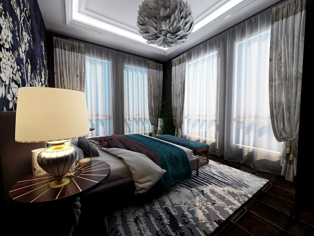 Luxurious glam bedroom with floor to ceiling drapes and teal accents by online interior designer Kassondra Leigh