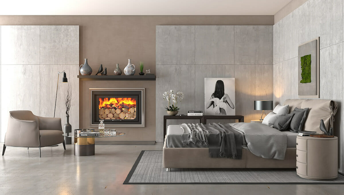 Contemporary master bedroom design with cozy fireplace seating area