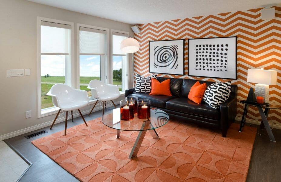 Geometric orange accent wall in living room design