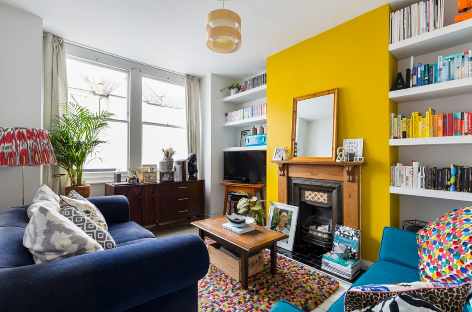 Magnificent yellow accent wall over the fireplace