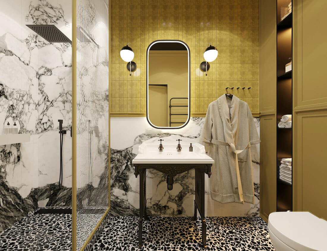 Yellow accent wall in an art deco bathroom