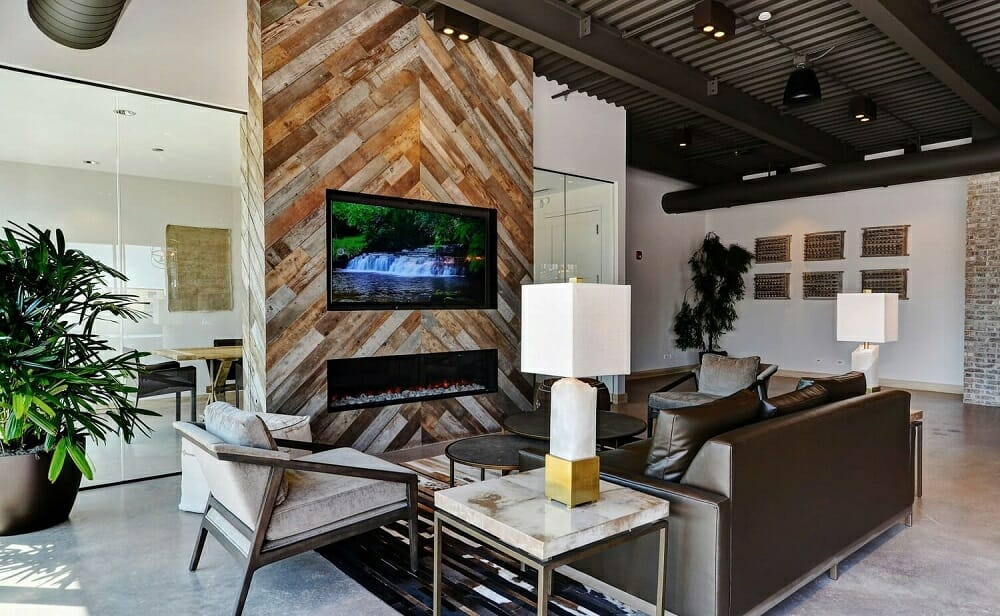 Open concept living room with industrial decor - Wanda P