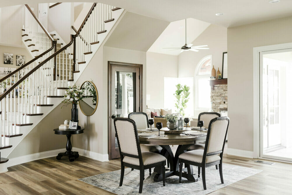 transitional dining and stairway by top fresno interior decorator parcel house