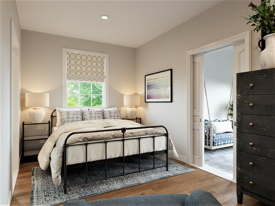 Coastal bedroom with a dresser and steel bedframe